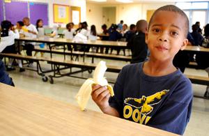 Cute boy eating a banana